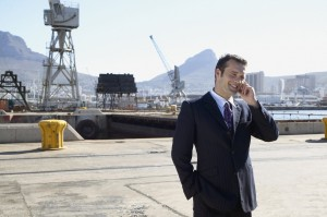 Portrait of a man talking on his mobile phone in an industrial setting